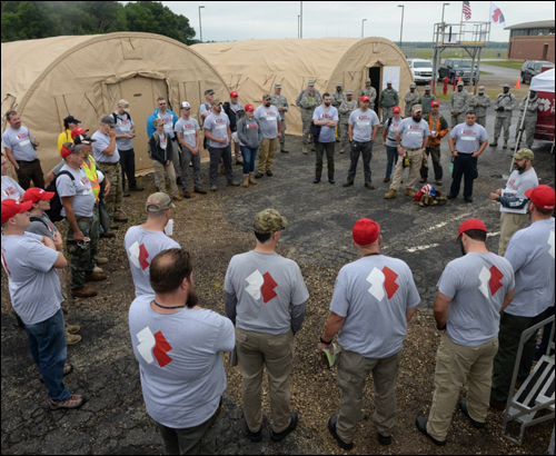 Team Rubicon, members of the National Guard Bureau and debris removal teams attend operational briefing at PATRIOT North 16'
